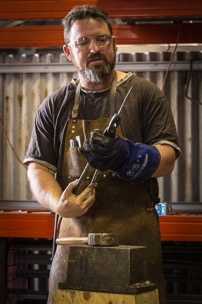 Adam Fromholtz blacksmithing at Tharwa Valley Forge